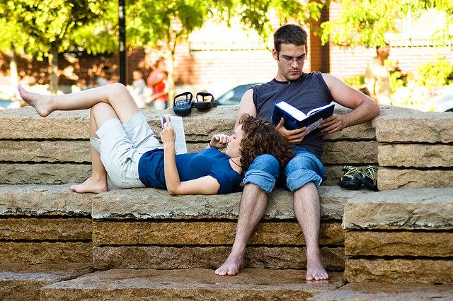 Couple reading in park